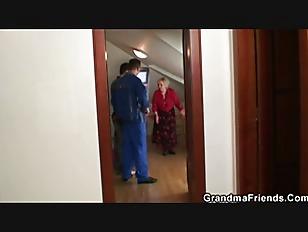Naughty granny pleases two repairmen