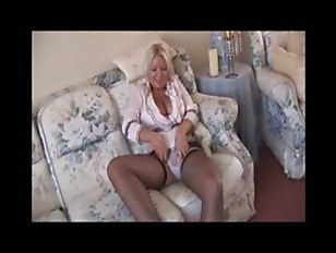 Busty mature babe in mini skir