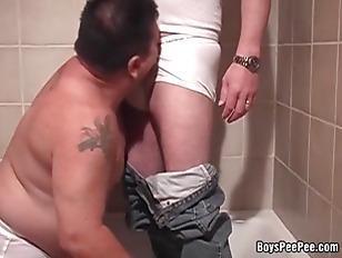 Fat tattooed dude sucking smal