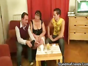 Fat mature babe takes two cock