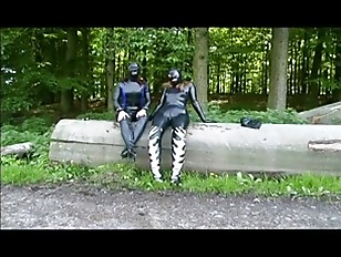 Two girls in latex touch each