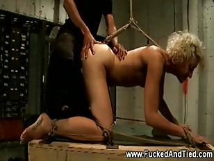 This submissive slut takes it from behind from her dominator