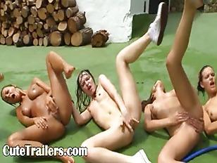 Five naked models getting wet