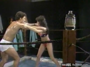 Picture Oiled Busty Chick Gets Banged In Ring