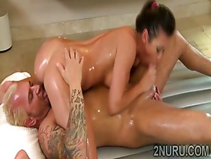 Big boobed hottie gives naughty Nuru massage to lucky client
