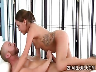 Gorgeous Asian masseuse with hot tattoos gives a naughty massage